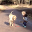 Dog Waits Patiently While Toddler Takes A Break To Splash Around In Puddle And We're In Love