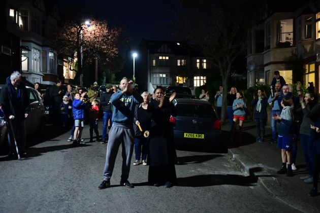 People in Woodford Green join in a national applause for the NHS from their doorsteps, windows and